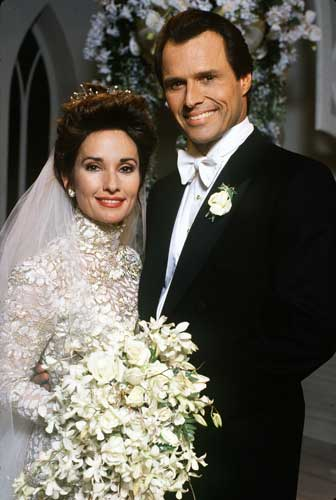 "<div class=""meta ""><span class=""caption-text "">In this publicity photo released by ABC, actors Susan Lucci as Erica and Michael Nader as Dimitri pose for their TV wedding portrait in 1993 on the ABC soap ""All My Children."" This was husband No. 9 on the long-running show for Lucci, who will wed a tenth husband in episodes to be aired in May 2005.  ((AP Photo/ABC, Ann Limongello))</span></div>"